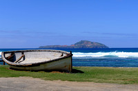 Longboat with Phillip Island in the Background